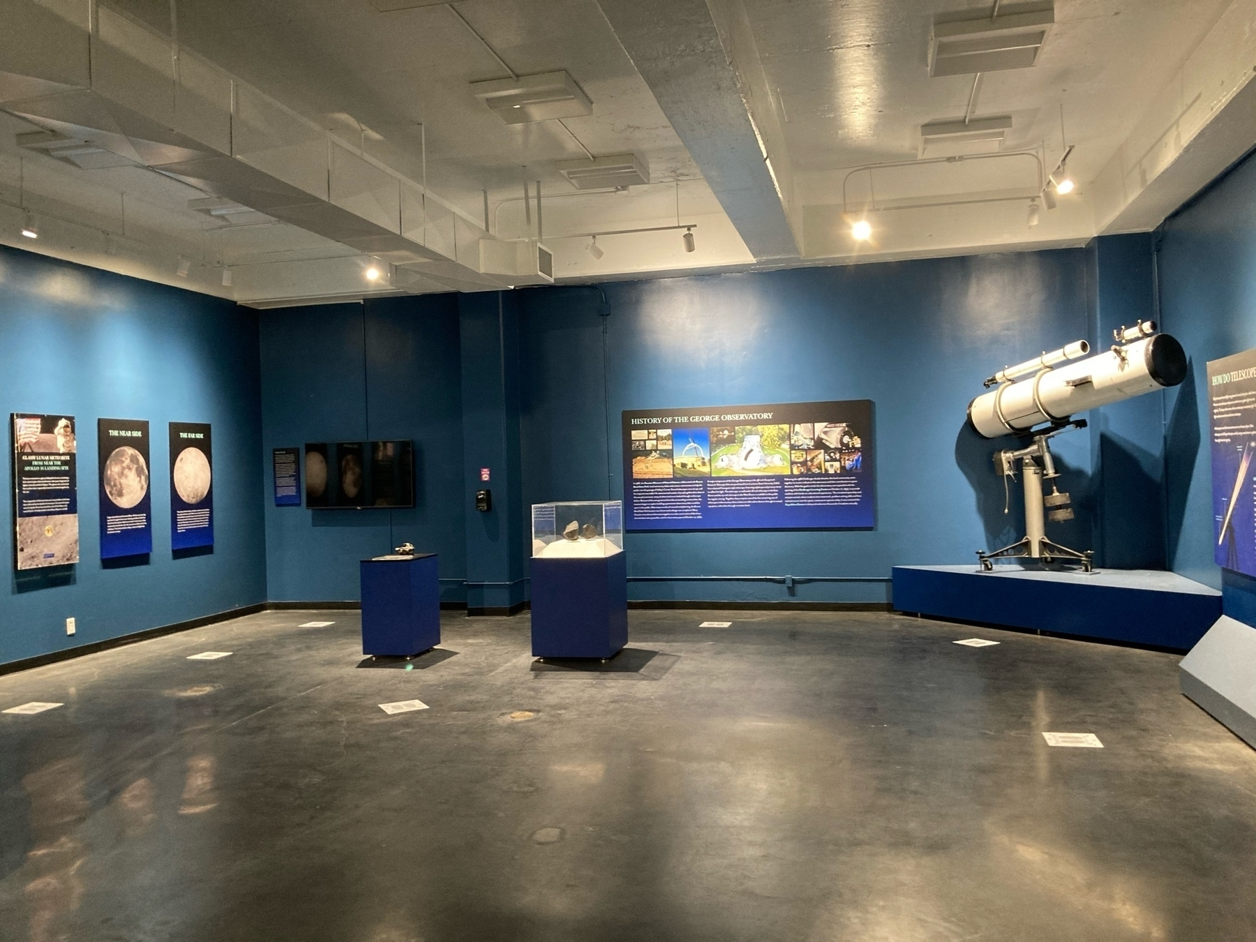 Room with telescopes and items on display