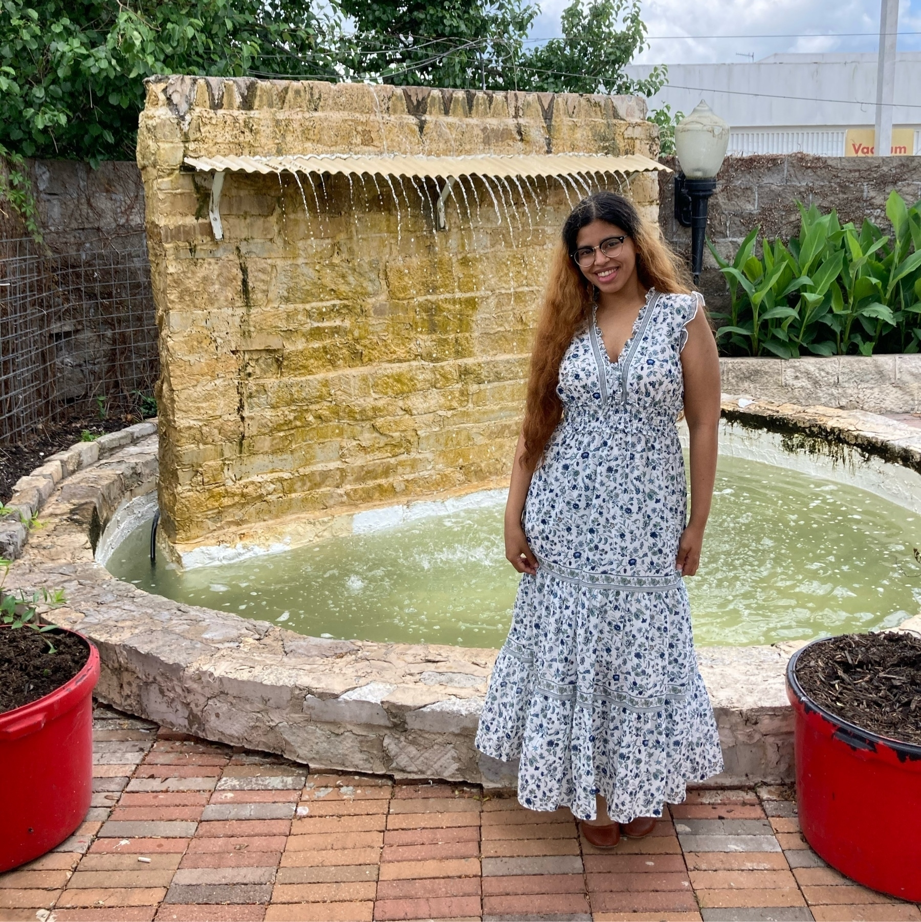 Me in a dress standing in front of a waterfall
