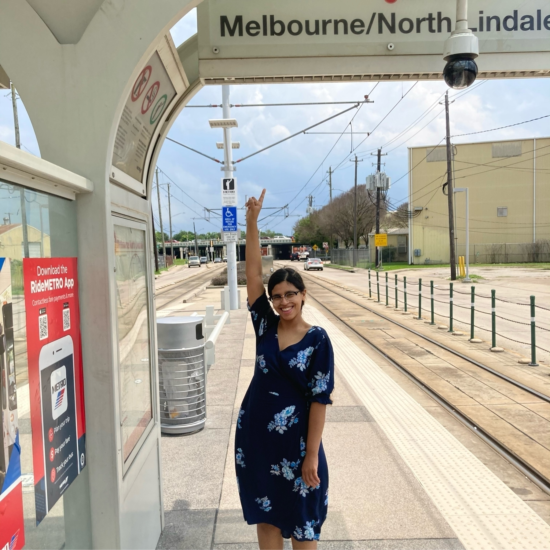me pointing to a stop that says Melbourne